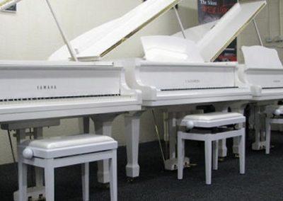 White Yamaha Grand Pianos